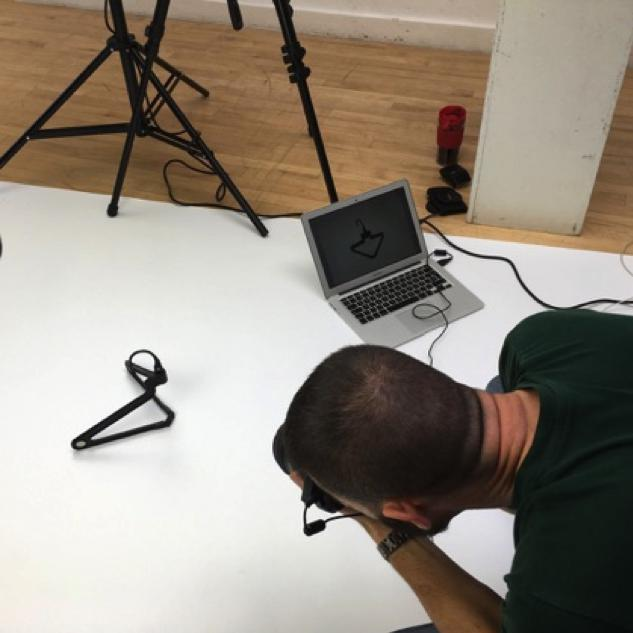 Gonçalo Diniz in the studio taking a shot of the PLIQO folding hanger.