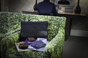 PLIQO Folding Garment Bag in a Hotel room