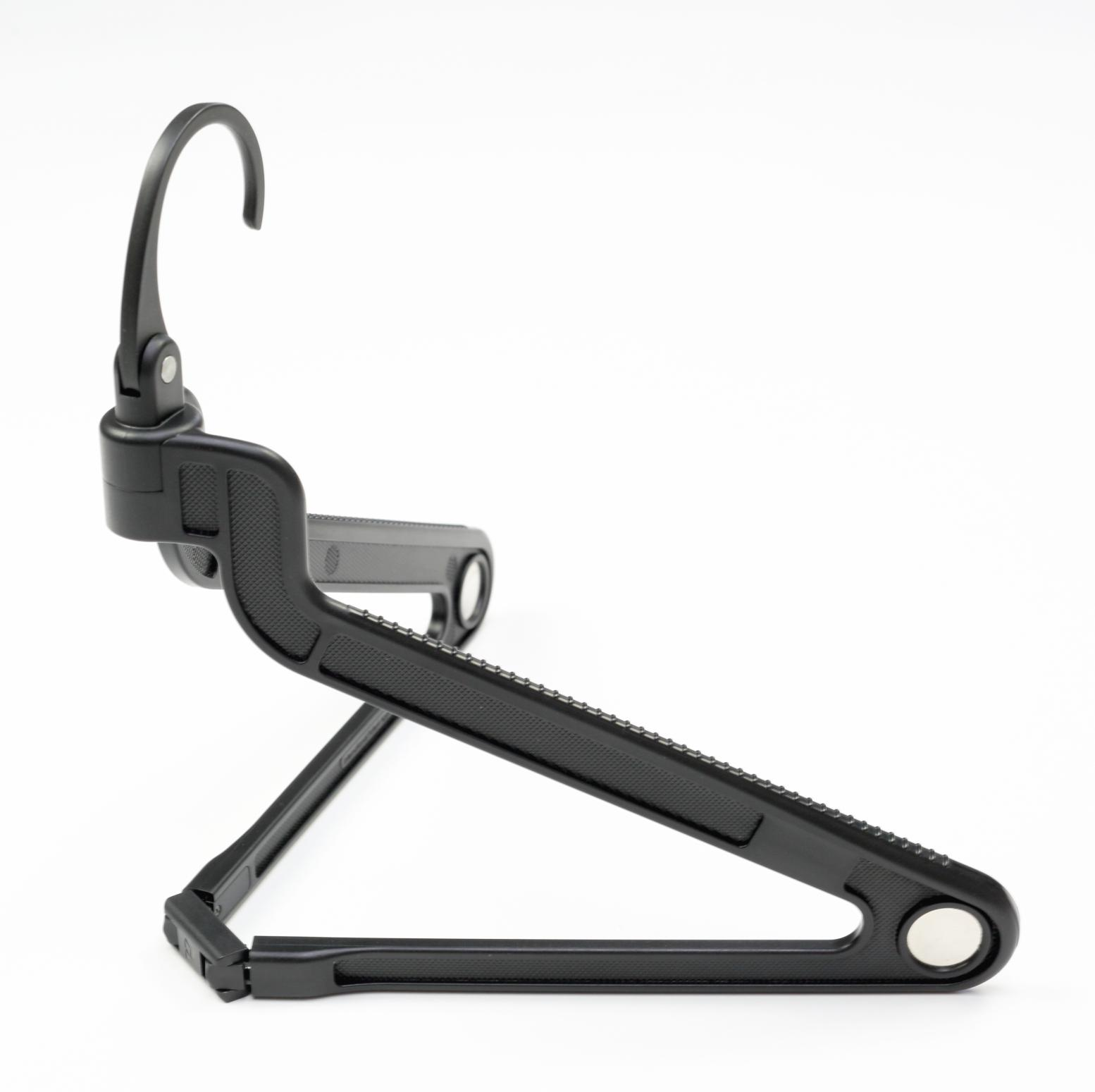 The PLIQO folding Hanger viewed from the side over a white background.